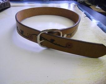 Leather floral design belt.