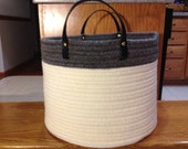 Wool braided basket in cream and flannel grey wool yarns,black leather handles and solid brass rivets