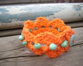 crocheted bracelet orange with wooden turquoise beads one size OOAK