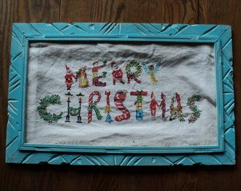 Vintage Hand Sewn EMBROIDERED LINEN SAMPLER in Non-Traditional Colors and each letter of Merry Christmas  is a different symbol of Christmas