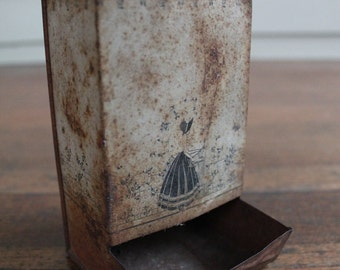 Vintage Rusty Tin Match Holder (Woman Standing at Gate)