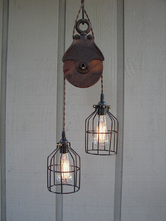 Upcycled vintage farm pulley lighting pendant with bulb cages for Uses for old pulleys