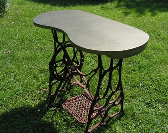 Early 1900's Kidney Bean Shaped Tabletop with Cast Iron Sewing Machine Base PICKUP ONLY