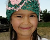 A Stretchy Green and Pink Cotton Floral Fishnet Headband with Scallop Trim for Girls and Teens