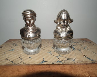 Vintage Dutch girl and boy salt pepper shakers crystal and silver metal