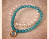 Fresh water pearls paired with mini turquoise stone bracelet with protector eye gold plated pendent