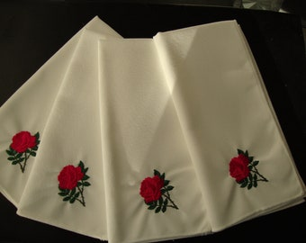Napkins embroidered with red roses