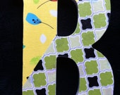 """8"""" wood letter 'B' - fabric topped, with green, black, yellow, blue, white, orange - flowers"""