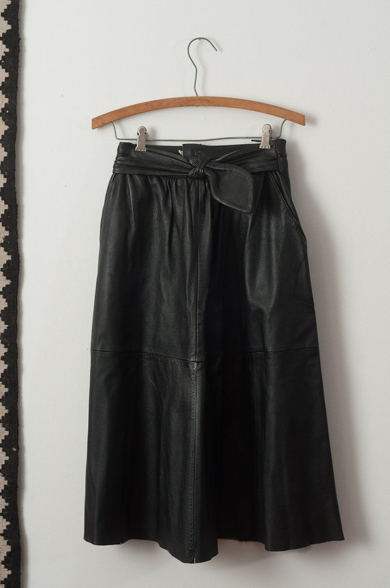 high waisted black leather skirt with waist detailing by