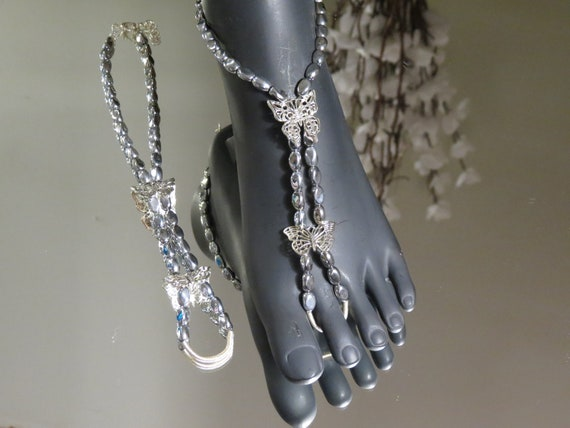 Butterfly Crystal Helix Beaded Barefoot Sandals on a thick durable elastic band. These have some give. Will fit shoe size 5-7 American Wome