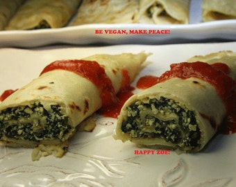 Vegan delicious crepes filled with organic delicious tofu and spinach, love, animal free cruelty,no eggs,no dairy.