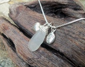 "Sea glass jewelry,  Frosted white sea glass with sterling silver puffy heart and ""love"" charm"