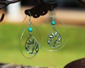 sterling silver earrings with teardrop center and turquoise bead