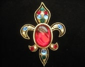 Vintage Jeweled Fleur de Lis Brooch has Rhinestones, Cabochons, and Pearls.  It is almost 3x2 inches.