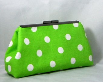 Green clutch with white dots lined with blue and green batik cotton lining