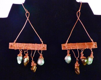 Hammered copper tubing, wire wrapped with blue and bronze colored natural blister fresh water pearls.