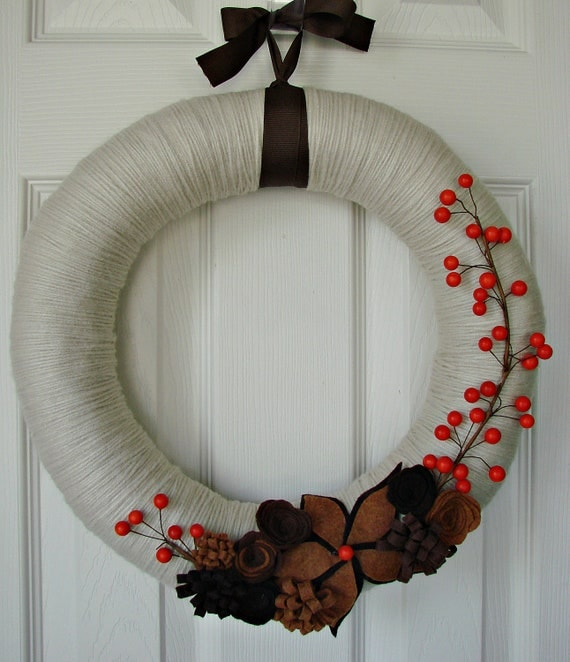 Ivory yarn wrapped wreath with 3 toned brown flowers and orange berries