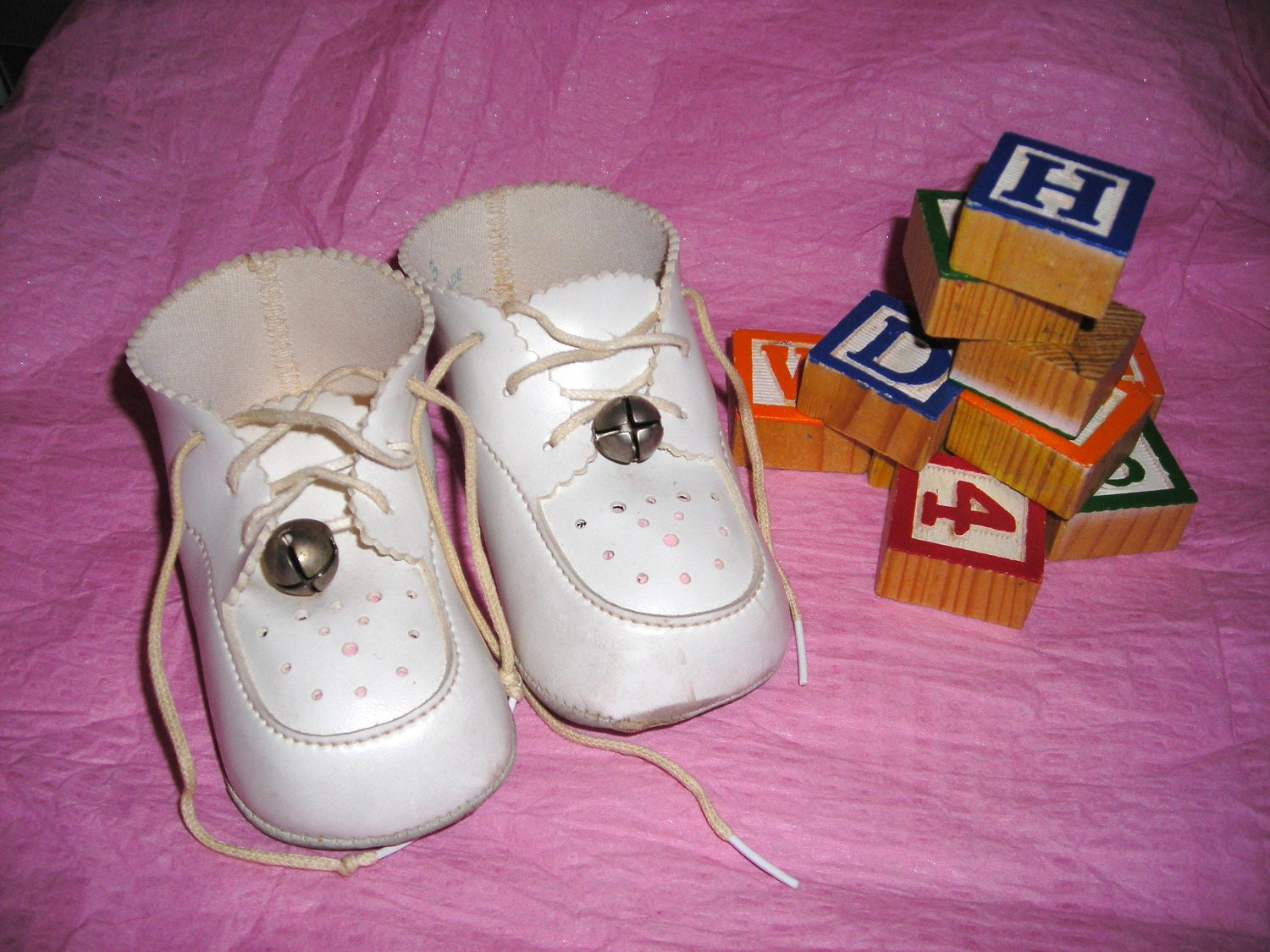Baby Shoes Three White Bells