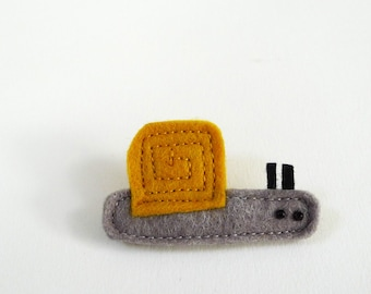 yellow snail brooch