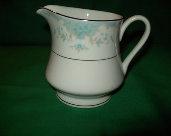 "One (1) Porcelain 3 5/8"" Creamer, by Prudence China, in the Antiquity 6305 Pattern."