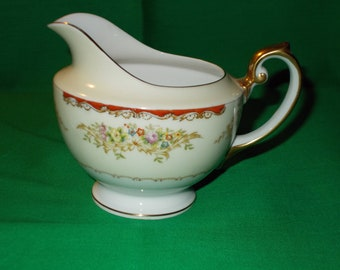 One (1), Porcelain Creamer, by Royal Embassy China, of Japan, in the RENO Pattern.