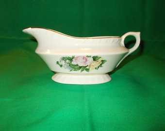 One (1), Gravy Boat, from American Limoges, in the Janis R132 Pattern.