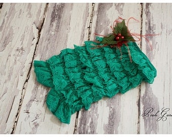 Holly Lace Rompers contain, holly and feather embellishments