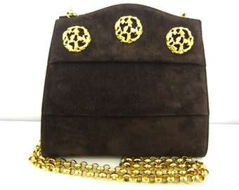 Vintage Salvatore Ferragamo dark brown suede leather party purse with golden decorative charms and chain. Unique shape.