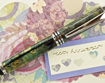 Hand turned Wooden Pen Handcrafted from Buckeye Burl Cast in Blue Fleck Acrylic Rhodium Hardware 326Q