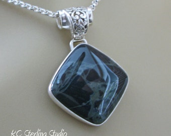 Black and gray spider web obsidian and sterling silver metalsmithed pendant necklace on rolo chain