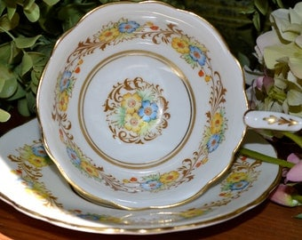 Vintage Royal Stafford Fine Bone China Tea Cup and Saucer, Yellow Blue Red Floral Motif, Gold Gilt, England
