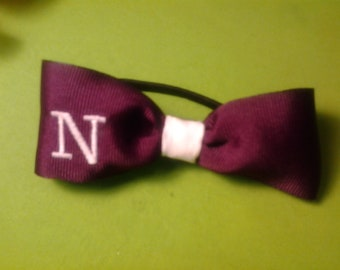 Simple bow with monogram One Letter on the wing