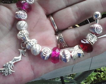 Red and silver,  Euro style bracelet fully loaded