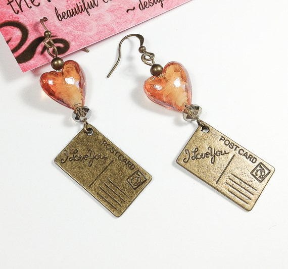 Dangle Earrings with Amber Heart Lampwork Glass Beads, Silver Grey Swarovski Crystals & Antique Bronze Postcard Charms