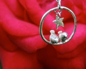 Two love birds sitting under the stars pendant necklace