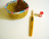 Small crocheted pot with liberty fabric