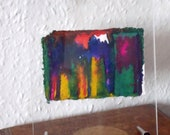 Small painting in yellow, navy and green