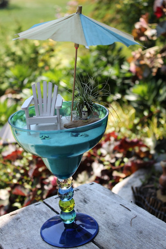 Miniature beach vacation with wine and umbrella by