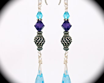 Beautiful and interesting sterling silver Bali bead and Swarovski aquamarine earring on sterling silver ear wires.