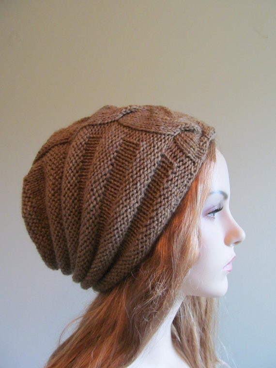 Slouchy Knit Beanie. Women's pink hand knitted cable hat. Slouchy hat. About: This soft and classic looking hat/beanie is so fashionable. It has been knit by hand with a gorgeous yarn that is made from 50% lambswool and 50% cotton.