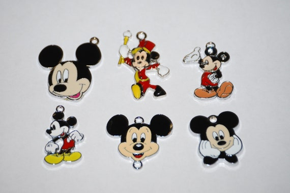 Six adorable enamel Mickey Mouse charms to use for zipper pull, backpack, cell phone, purse clip, bracelet, necklace or scrapbooking.