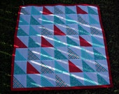 Red, white and turquoise triangle baby quilt
