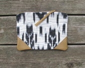 LAST ONE: leather clutch, black & white woven cotton, sand leather