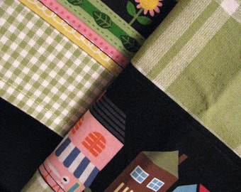 Kitshy kitchen tea towels, retro, mod, colorful row houses and flowers