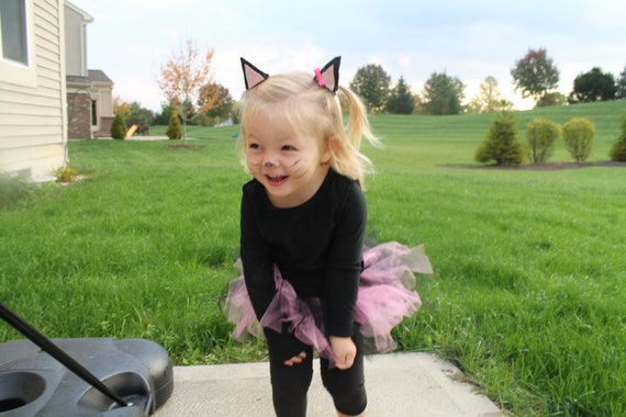 Children Cat Costumes We have a huge selection of really fun cat costumes for your child to choose from for Halloween or just for a great animal style dress up idea. We have everything from the very cute and cuddly cat costumes to the more traditionally for Halloween-style cat get ups.