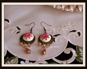 Fucasia pink copper filigree earrings.