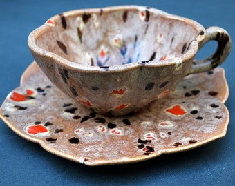 Truly Unique Decorated Brown Ceramic Teacup and Petal Shaped Saucer