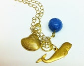 Gold Whale, shell, and blue bead  charm necklace