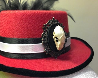 The Woman In Red: Lipstick Red Mini Top Hat Fascinator Featuring Real Bat Skull Cameo On Black And White Band