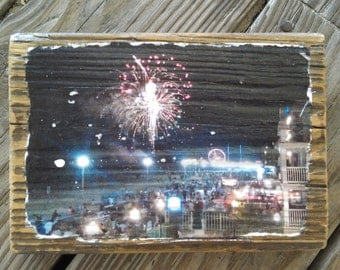 Color photograph of fireworks at the pier in Ocean City MD transferred onto reclaimed boardwalk wood